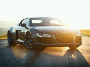 Audi sports car with sun shining behind it