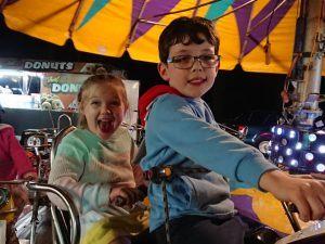 Happy children on a merry go round