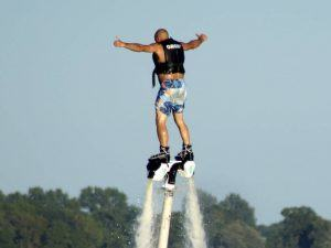 Man in mid air using a water jet pack