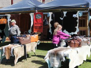 Leathercraft and cow hides for sale at a fair